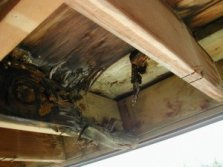 This wood underlayment is wood here is completely deteriorated, leaving the balcony occupants at risk should the concrete crack.